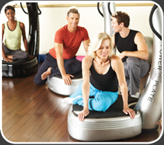 Group of Young People Using Powerplate Machines