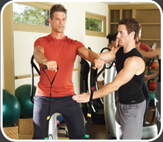 Personal Trainer and Young Man using Powerplate Machine for Resistance Training